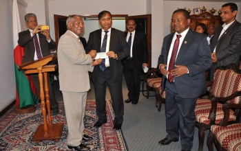 Ambassador Mr C.B. Thapliyal hands over of Cash Grant of US$ 37,350 to the President of Senate